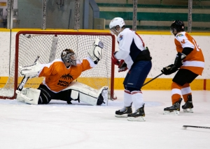 Adrien Hervillard makes a glove save on Nov. 30, 2012 against Simon Fraser. - PHOTO BY ALLEN DOUGLAS