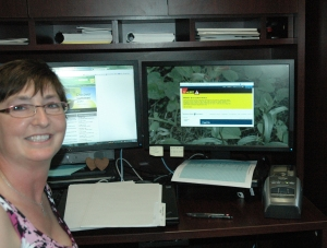 TRU manager of occupational health and safety Stacey Jyrkkanen shows off what the screens around campus will look like should they need to engage the emergency notification system.          —PHOTO BY MIKE DAVIES